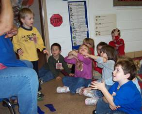 Here children are signing 'Good Morning.'  This class is one of several in our agency that is incorporating sign language as part of their curriculum.